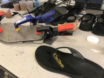 A flip flop on a work bench
