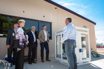 New Mexico U.S. Senator Martin Heinrich and Lab officials tour the DC microgrid
