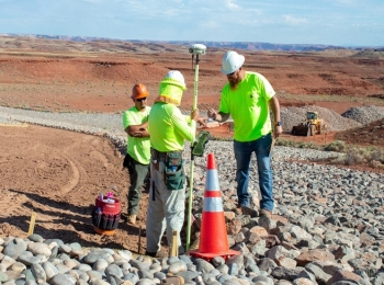 An industrial hygienist monitors workers during LM's Mexican Hat interim cover protection project for signs and symptoms of heat stress.