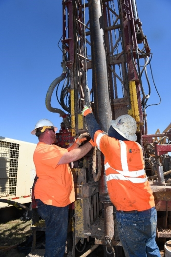 Employees adjust a bioremediation systems injection well at the Pantex Plant.