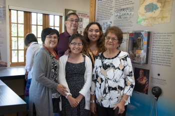 The family of Sam Billison stand with the Navajo Code Talker G.I. Joe on display at LM's Atomic Legacy Cabin in Grand Junction, Colorado.
