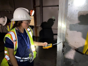 Emerson Brazile, a Nuclear Waste Partnership (NWP) summer intern, measures pressure across the bulkhead in the Waste Isolation Pilot Plant (WIPP) underground.