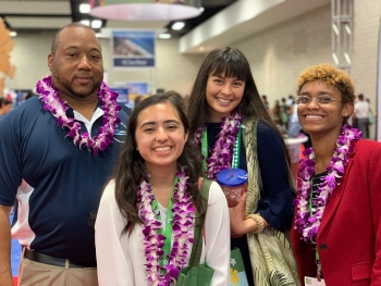 Alyssa Renteria (front center) is pictured here with Clarence Brown, director of the Mentorship for Environmental Scholars Program, and peers at a STEM diversity conference in Honolulu.