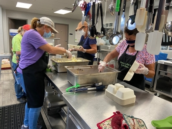 Marcella's Kitchen volunteers prepare meals to be packaged and distributed to those in need in Marshall County.