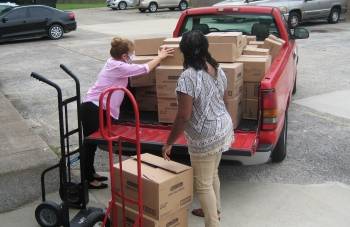 Paducah Cooperative Ministries Executive Director Heidi Suhrheinrich and emergency Services/Volunteer Coordinator Karen Burton unload a truckload of food purchased with recently donated funds from the Feds Feed Families campaign.