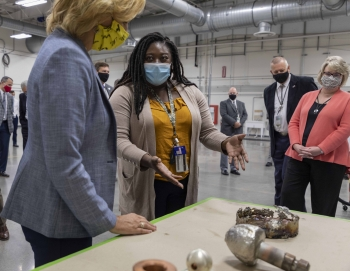 Y-12 Principal Investigator Felicia Rutland shows NNSA Administrator Lisa E Gordon-Hagerty items used in the Test and Demonstration Facility.