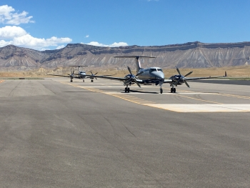 NNSA aircraft taxi to the portion of the Grand Junction runway dedicated to calibration pads.