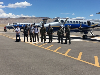 NNSA staff pose beside aircraft outfitted with radiation sensor systems at the Grand Junction, Colorado, airport.