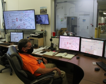 Steve Rust, a nuclear chemical operator for contractor CH2M HILL Plateau Remediation Company, monitors the performance of the 200 West Pump and Treat Facility from the control room on the Hanford Site.