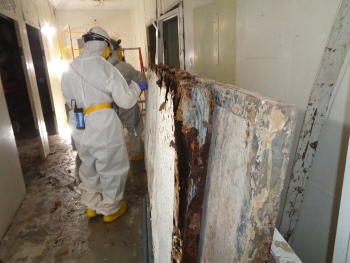 Crews in full protective gear have been conducting asbestos abatement inside remaining Biology Complex buildings at Oak Ridge since early 2019.