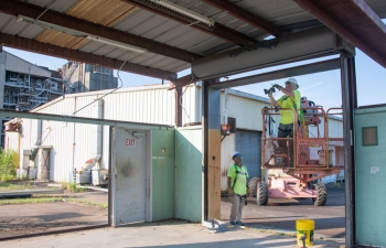 Subcontractor employees managed by Savannah River Nuclear Solutions dismantle one of six Savannah River Site buildings for donation to the Savannah River Site Community Reuse Organization.