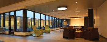 Interior photo of a behavioral health unit, with assorted chairs and lots of windows.