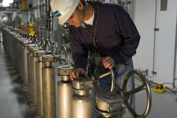 An employee works on the CSSX tank cell operating deck at the Salt Waste Processing Facility.