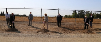 NNSA Administrator Lisa E. Gordon-Hagerty, flanked by NNSA and Lawrence Livermore National Laboratory staff, breaks ground on the Lab's new Emergency Operations Center.