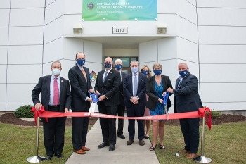 Participants in a ceremonial ribbon-cutting for the Salt Waste Processing Facility (SWPF) at the Savannah River Site on Sept. 24