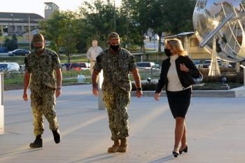 U.S. Strategic Command's Adm. Charles Richard walks with NNSA Administrator Lisa E. Gordon-Hagerty to their meeting.