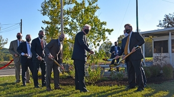Following the event celebrating the achievement of Vision 2020 at Oak Ridge, attendees gathered for a tree planting and dedicated a small park named Crossroads Common at the East Tennessee Technology Park.