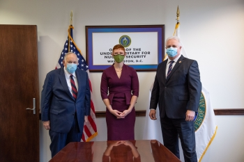 Ambassador Linton Brooks, left, and Dr. William Bookless, NNSA Principal Deputy Administrator, with Jennifer Harder from the Office of Defense Programs.