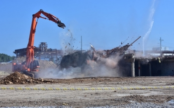 A view of demolition on the final uranium enrichment building at the East Tennessee Technology Park at Oak Ridge.