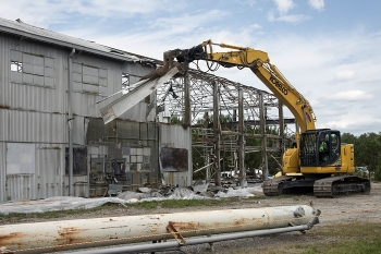 At the height of the Cold War, the Ford Building was used to test components used in five nuclear reactors at the Savannah River Site. An excavator is shown here removing a section of the facility's metal roof.