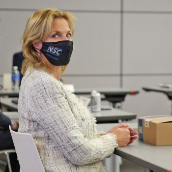 NNSA Administrator Lisa E. Gordon-Hagerty listens to a manager from Kansas City National Security Campus.