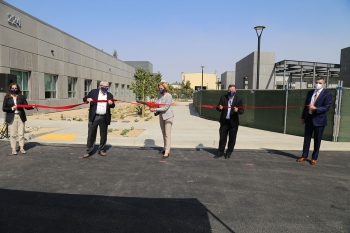 NNSA Administrator Lisa E. Gordon-Hagerty, joined by team members from NNSA and Lawrence Livermore National Laboratory, cuts the ribbon on the Lab's new Applied Materials and Engineering Campus.