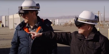 Doug Fenske, left, and Byron Gessel, team members with EM Richland Operations Office contractor Mission Support Alliance, demonstrate the use of location intelligence and mixed reality to locate underground utilities.