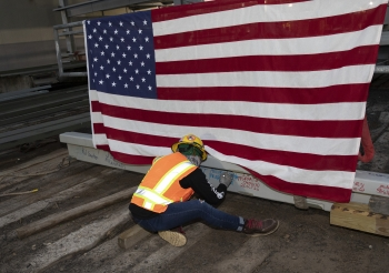 """A UPF employee signs the last piece of structural steel at Y-12's Oct. 26 """"topping out"""" ceremony."""