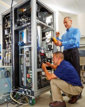 Rey Suarez, left, and Jim Hayes of Pacific Northwest National Laboratory work on the Xenon International prototype.