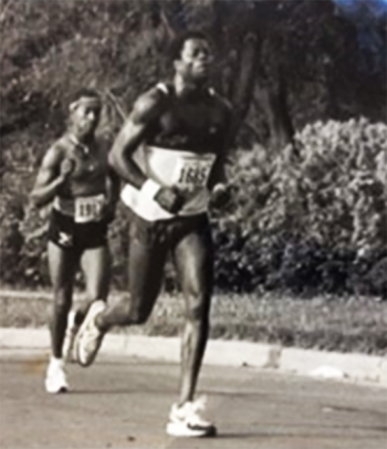 NNSA employee Cheran Shields (left) running in a marathon.