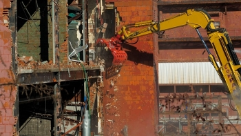 EM workers begin tearing down Building 9210 at Oak Ridge on Nov. 16.