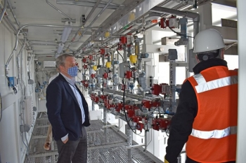 """During a visit to the Hanford Site last week, EM Senior Advisor William """"Ike"""" White, left, got a look inside enclosures for the pretreatment system that will prepare waste from Hanford's large underground tanks."""