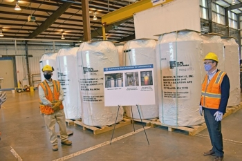 """EM Senior Advisor William """"Ike"""" White, right, stopped by the Waste Treatment and Immobilization Plant during a visit to the Hanford Site last week and saw the first 20 containers that will hold waste simulant and tank waste that is vitrified."""