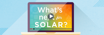 "A laptop with a screen that says ""What's Next for Solar?"" with a play button"