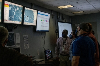 Employees at SRS monitor the first transfer of waste to the SWPF