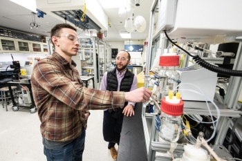 NREL researchers Joseph Roback (left) and Nolan Wilson (right) study separation approaches to isolate purified chemical products using scalable and cost-effective unit operations.