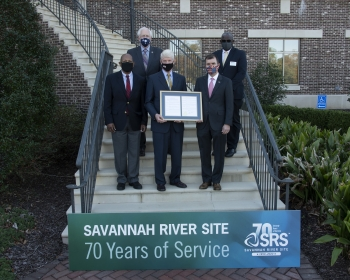 Elected officials gathered with Site leaders on the steps of the Aiken Municipal Building on Nov. 16 to bestow the framed resolution to the SRS.