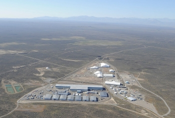 The Transuranic Storage Area Retrieval Enclosure — the wide T-shaped building in the foreground — is undergoing closure under federal and state regulations at the Radioactive Waste Management Complex at the Idaho National Laboratory Site.