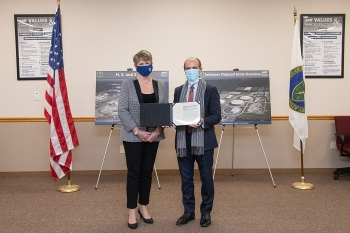 Deputy Secretary Mark W. Menezes presents Salt Waste Processing Facility Federal Project Director Pam Marks with the Secretary's Appreciation Award for Management Excellence on Dec. 4.