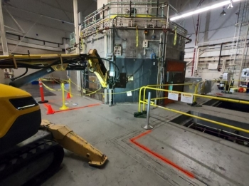 Workers conduct a simulated demolition as part of a study to determine potential impacts from the Livermore Pool Type Reactor demolition scheduled to begin in spring next year.