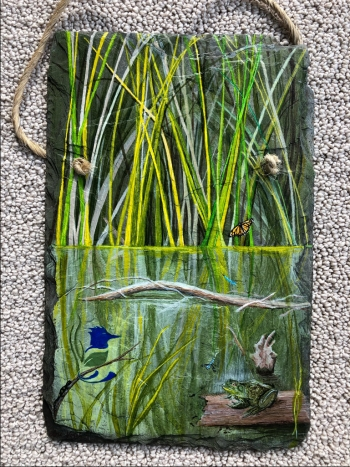 A hand painted slate, gifted to Smiley, depicting a scene from one of Fernald Preserve's award-winning restored wetland habitats.