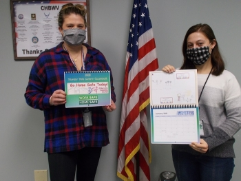 Pictured with this year's Family Fun Safety Calendar are Jordan Seltzer, left, and Mary Janik with the CH2M HILL BWXT West Valley records management division.