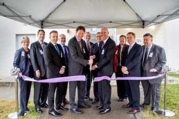 In this 2019 photo, officials cut a ribbon to mark the launch of a new public-private partnership that provides unique isotopes to aid in next-generation cancer research and treatment while advancing nuclear cleanup at Oak Ridge.
