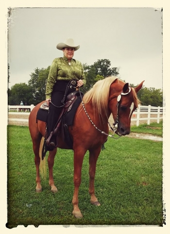 Smiley and her horse Ginger ready for a ride.
