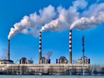 Power plant with smokestacks.