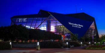 Photo of Mercedes-Benz Stadium at night in Atlanta.