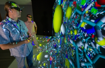 National Renewable Energy Laboratory Senior Scientists Ross Larsen (left) and Travis Kemper examine a molecular model at the Energy Systems Integration Facility.