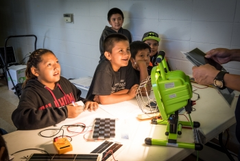 Photo of a group of children learning about solar panels