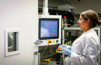 A cancer researcher prepares to irradiate a cell sample using an X-ray irradiator (pictured). This particular irradiator was provided under a partnership with NNSA under the Cesium Irradiator Replacement Project.