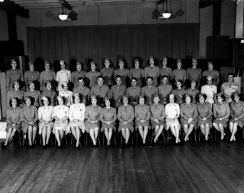 A Group of Army Corps Members & Nurses Pose for a Photograph